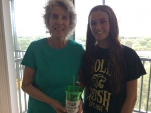 Maggie and Recipient with Water On Wheels reusable tumbler.